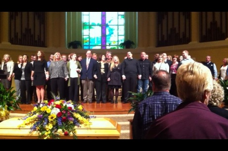 Friends of Jason Molitor from twenty-five years of Arkansas Tech Wesley sing together at his send-off.