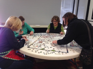 Even the cooks from Bible Soup took time to help us work on the puzzle project.