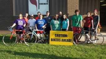 Bikers from TdF 2014 pose outside of Des Arc UMC. After 200 miles on a bike together, you're more or less family.