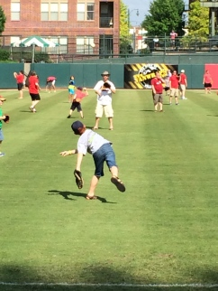 Zachary and I play a Father's Day game of catch on the field at Autozone Park.