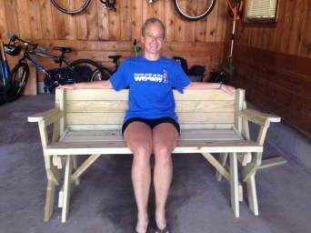 Denise tries out the bench we built this weekend.