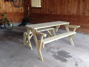 With a few adjustments, the bench folded out into a table, just as it was designed. A little experience made this a quick fix.